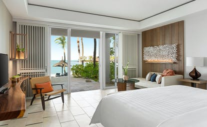 Junior suite with beach access bedroom with large double bed, television and seating area