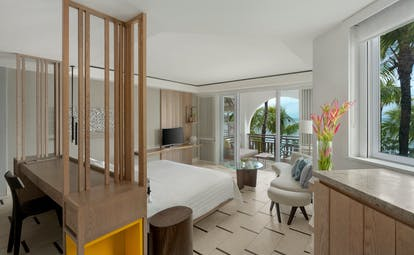 Junior suite with ocean view bedroom with large double bed and balcony looking over the ocean