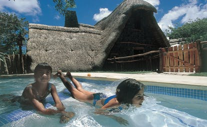 Shangri La Le Touessrok Mauritius kids pool two young girls in small pool