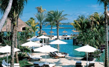 Shangri La Le Touessrok Mauritius outdoor pool loungers umbrellas palms ocean view