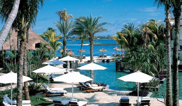 Shangri La Le Touessrok Mauritius outdoor pool loungers umbrellas palms ocean view