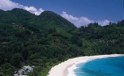 Banyan Tree Seychelles aerial bay forested mountains ocean beach