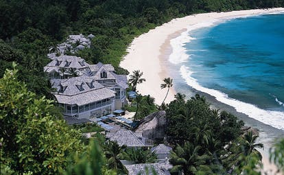 Banyan Tree Seychelles aerial view hotel complex forested hills beach ocean