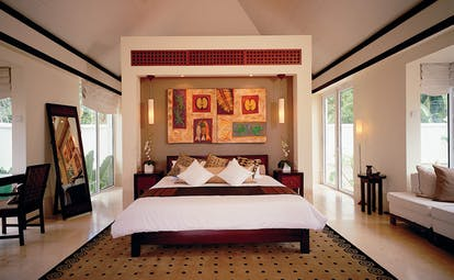 Banyan Tree Seychelles art bedroom bed in recessed nook with modern art