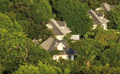 Banyan Tree Seychelles forest aerial view of white villas nestled in forest