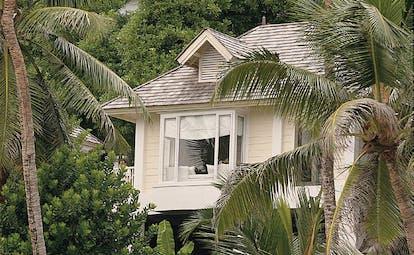 Banyan Tree Seychelles hillside pool villa white building palm forest