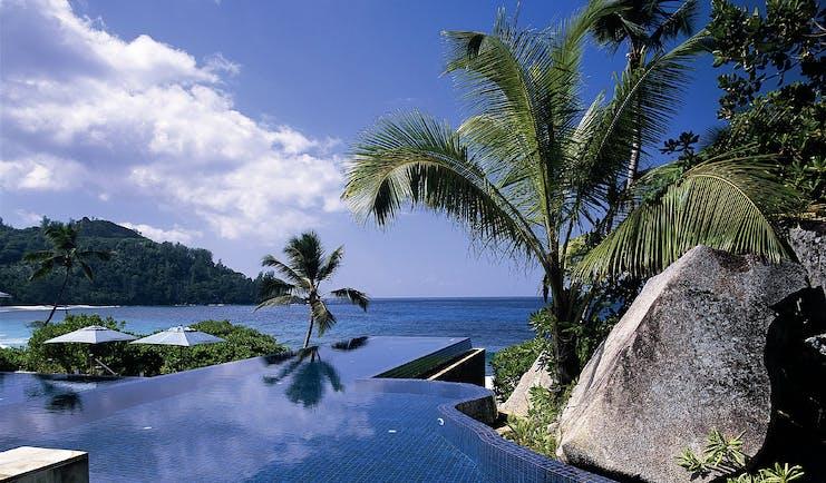 Banyan Tree Seychelles infinity pool rocks palm trees ocean view