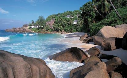 Banyan Tree Seychelles intendance bay rocks white sands waves palm forest