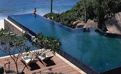 Banyan Tree Seychelles outdoor pool deck loungers ocean view