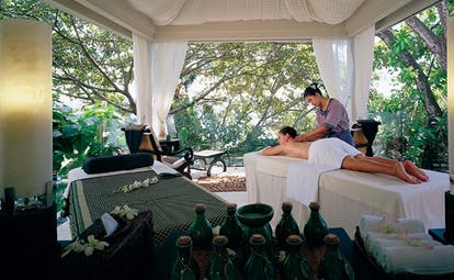 Banyan Tree Seychelles outdoor spa pavilion woman getting a massage
