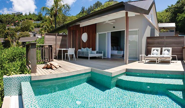 Carana Beach Hotel ocean view chalet exterior, decking sun loungers, priavte pool