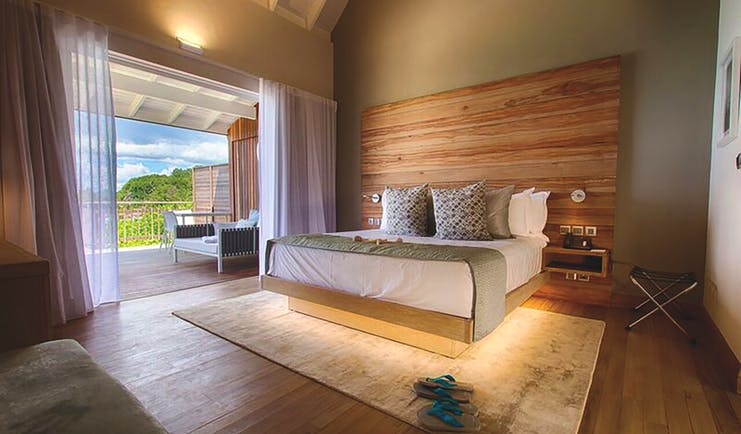 Carana Beach Hotel ocean view chaler interior, double bed, access to terrace, fresh modern decor