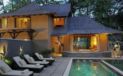 Constance Ephelia Resort Seychelles beach villa exterior yellow building sun loungers pool terrace