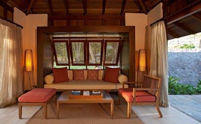 Constance Ephelia Resort Seychelles beach villa outdoor lounge sofa coffee table access to garden and to villa