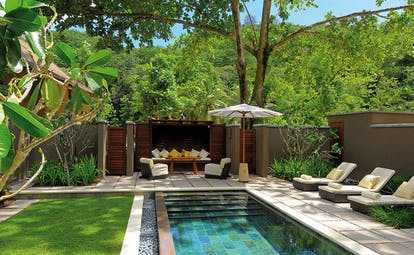 Constance Ephelia Resort Seychelles beach villa pool lawn pool loungers seating area forest views