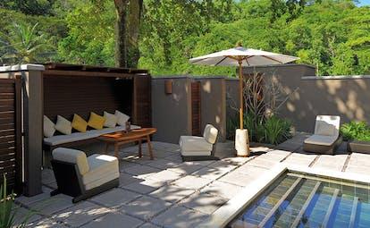 Constance Ephelia Resort Seychelles beach villa terrace sofa armchairs umbrellas private pool
