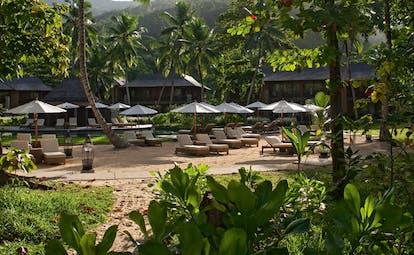 Constance Ephelia Resort Seychelles garden beach sun loungers umbrellas lanterns