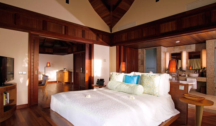Constance Ephelia Resort Seychelles hillside villa bedroom open plan view of lounge