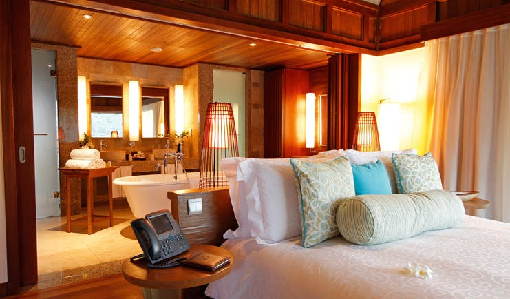 Constance Ephelia Resort Seychelles hillside villa interior open plan bedroom and bathroom