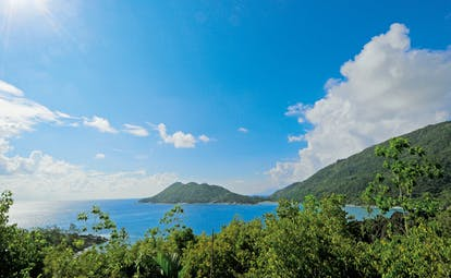 Constance Ephelia Resort Seychelles island view ocean forest covered island