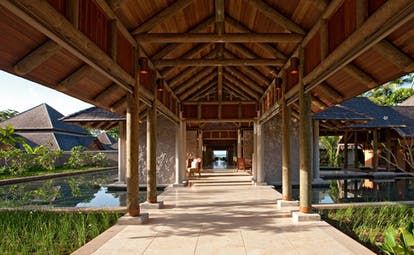 Constance Ephelia Resort Seychelles main entrance covered walkway outdoor pool