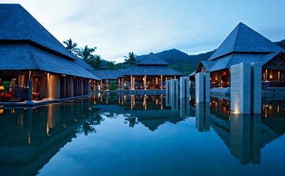 Constance Ephelia Resort Seychelles main outdoor pool buildings mountains