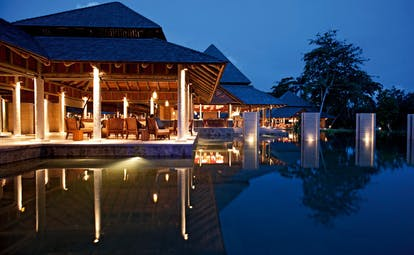 Constance Ephelia Resort Seychelles outdoor terrace pavilion outdoor pool night time