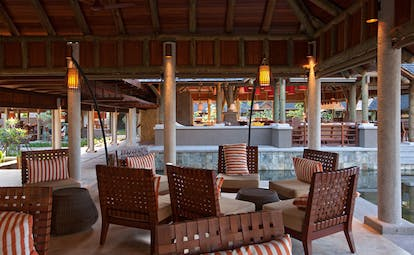 Constance Ephelia Resort Seychelles pool terrace seating area outdoor dining