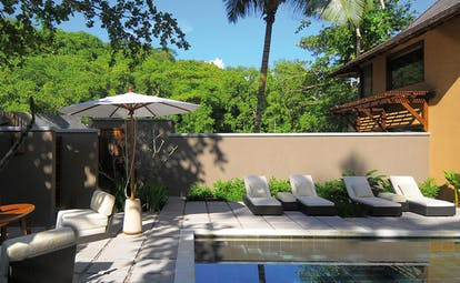Constance Ephelia Resort Seychelles private pool sun loungers lounge area