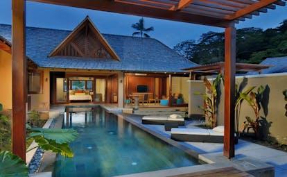 Constance Ephelia Resort Seychelles spa villa exterior pool loungers view of villa and bedroom