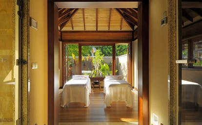 Constance Ephelia Resort Seychelles spa villa treatment room two spa beds