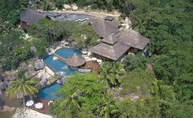 Constance Lemuria Seychelles aerial view hotel complex forest outdoor pools