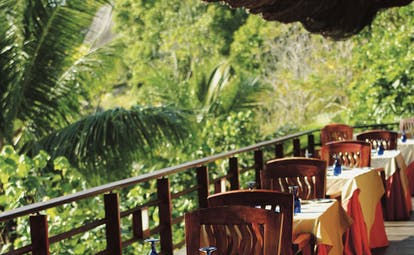 Constance Lemuria Seychelles balcony dining deck greenery