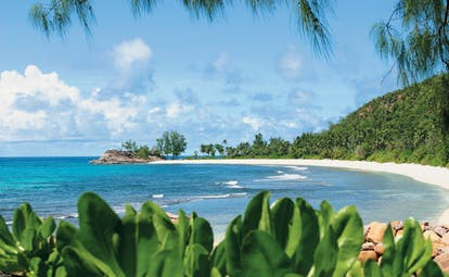 Constance Lemuria Seychelles beach view white sands greenery