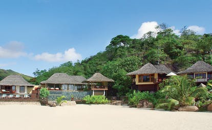 Constance Lemuria Seychelles bungalow beach thatched roofed villas forests