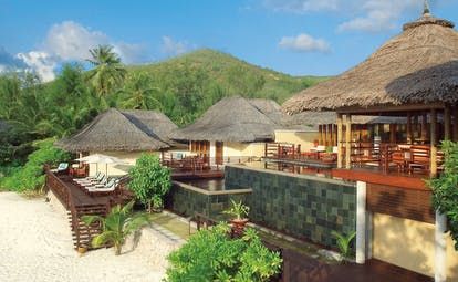 Constance Lemuria Seychelles bungalows thatched rooves deck loungers beach view