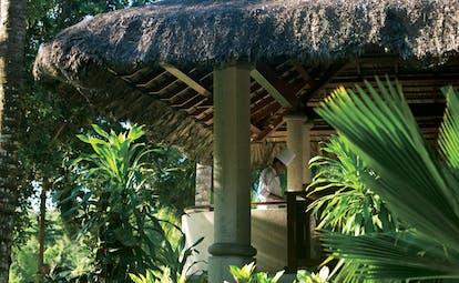 Constance Lemuria Seychelles hut restaurant exterior chef preparing food in a pavilion