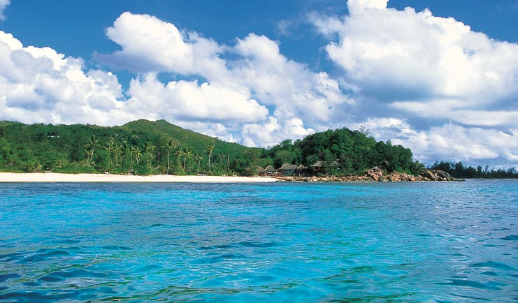 Constance Lemuria Seychelles island view forest beach thatched buildings