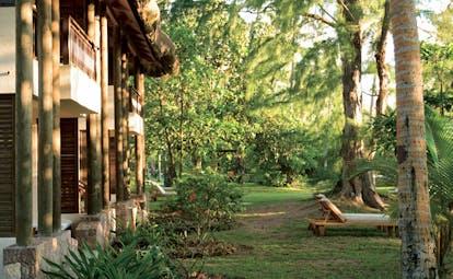 Constance Lemuria Seychelles junior suite garden sun loungers trees