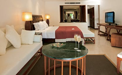 Constance Lemuria Seychelles junior suite bedroom sitting area champagne