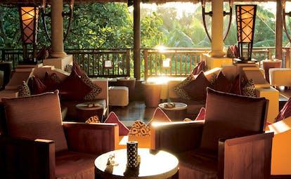 Constance Lemuria Seychelles main bar pavilion armchairs forest view