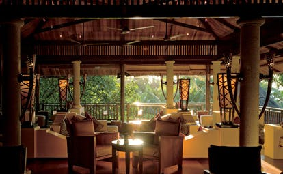 Constance Lemuria Seychelles main bar covered pavilion seating area forest view
