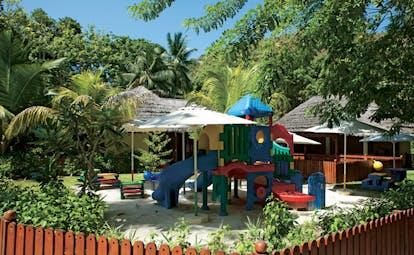 Constance Lemuria Seychelles outdoor play area in garden