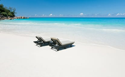 Constance Lemuria Seychelles private beach white sand loungers