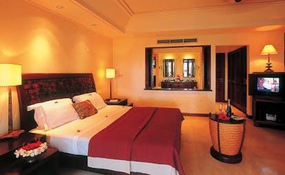 Constance Lemuria Seychelles sensuite bedroom tropical flowers minimalist decor wine