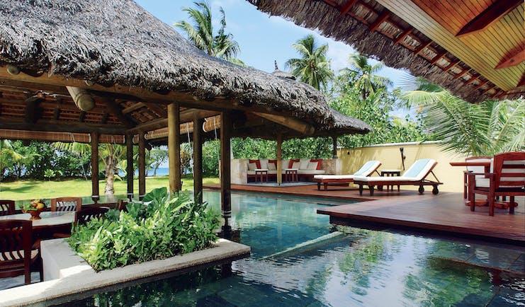 Constance Lemuria Seychelles villa garden private pool dining area loungers garden ocean view