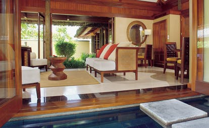Constance Lemuria Seychelles villa lounge sofas stepping stone into pool