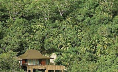 Four Seasons Resort villa exterior, building nestled amongst tropical greenery