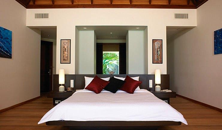 Hilton Labriz Seychelles beach villa bedroom modern decor and artwork