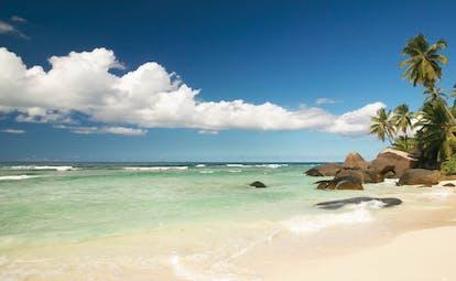 Hilton Labriz Seychelles beach white sand palm trees